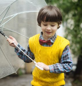 Boy carrying umbrella